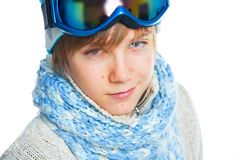 Portrait of a caucasian teenager in ski wearing. Clouse up portrait of a caucasian cute teenager in ski goggles and a scarf, isolated on white Stock Image