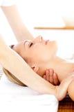 Portrait of a caucasian woman having a massage Royalty Free Stock Photos