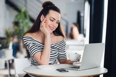 Portrait of caucasian woman working at home in front of a laptop. Young businesswoman working at home in the morning and Stock Images