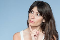 Portrait of caucasian young woman with long hair and bangs. thou Royalty Free Stock Photo