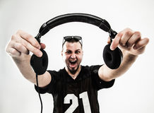 Portrait of a charismatic disc jockey with headphones in the for royalty free stock photography