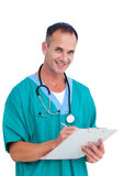 Portrait a charismatic male doctor writing notes. Against a white background Royalty Free Stock Images