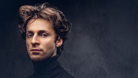 Portrait of a charismatic sensual male in black sweater. Creativ. E personality Stock Images