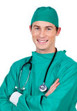 Portrait of a charismatic surgeon with folded arms Royalty Free Stock Photos
