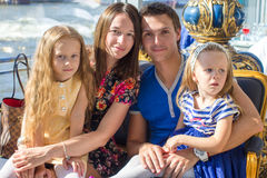 Portrait charming beautiful family of four in restaraunt Royalty Free Stock Photography