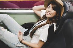 Portrait charming beautiful traveler woman. Beautiful woman sits royalty free stock photography