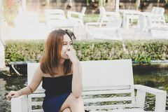 Portrait charming beautiful young woman: Attractive asian girl is looking something that make her laughing. stock image