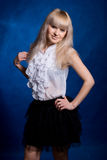 Portrait of charming blonde on a blue background. Royalty Free Stock Image