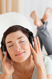 Portrait of a charming brunette listening to music Royalty Free Stock Image