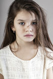 Portrait of a charming brunette little girl Stock Photos