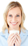 Portrait of a charming businesswoman holding a cup Stock Photography