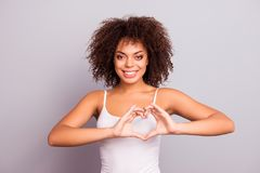 Portrait of charming cheerful pretty cute sweet attractive brunette girl sending love symbol, making heart figure with fingers, l. Ooking at camera, isolated on royalty free stock photos