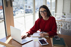 Portrait of charming female copywriter making researchers Royalty Free Stock Images