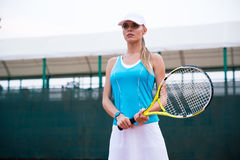 Portrait of a charming female tennis player Stock Image
