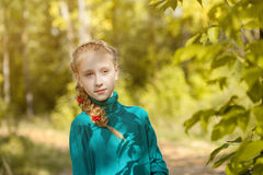 Portrait of charming freckled girl with pigtail Royalty Free Stock Image