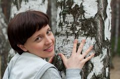 Portrait of charming girl in birch forest Royalty Free Stock Photo