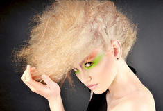 Portrait of charming girl with fantasy makeup and hairstyle. Stock Photos