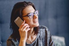 Portrait of a charming girl in glasses with a telephone stock photos