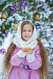 Portrait of charming girl in a pink coat and white scarf Stock Images