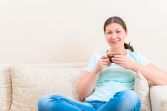 Portrait of a charming girl sitting on the couch Stock Photography