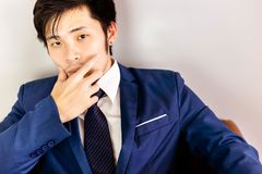 Portrait charming handsome young businessman. Attractive handsom stock photography