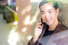 Portrait charming handsome young man. Attractive man is talking stock images