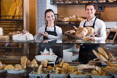 Portrait of charming happy smiling couple at bakery display Royalty Free Stock Photography