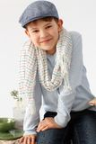 Portrait of charming little boy. In hat, smiling, looking at camera Stock Image