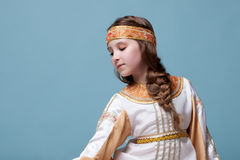 Portrait of charming little folk dancer. Posing on blue background royalty free stock photos
