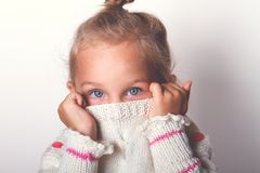 Portrait of a charming little girl in beige sweate. Stock Images