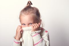 Portrait of a charming little girl in beige sweate Royalty Free Stock Photography