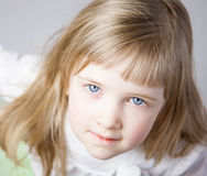 Portrait of a charming little girl Stock Images