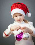 Portrait of a charming little girl in Santa's hat Royalty Free Stock Images
