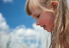 Portrait of a charming little girl. On sky background Royalty Free Stock Photos