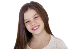 Portrait of a charming little girl smiling at camera Royalty Free Stock Photo