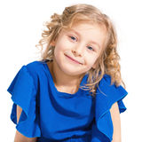 Portrait of a charming little girl on a white background. Stock Image