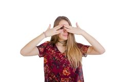 Portrait of a charming long-haired girl covering her eyes with p Royalty Free Stock Photo