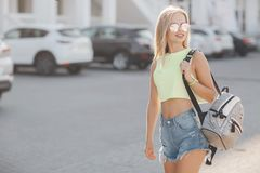 Young beautiful blonde woman with a bag in his hand, street summer outdoors stock image