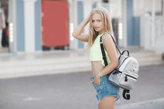 Young beautiful blonde woman with a bag in his hand, street summer outdoors stock photography