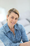 Portrait of charming mature blond woman Stock Photos