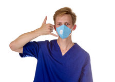 Portrait of a charming medical doctor gesturing call me with his Royalty Free Stock Photos
