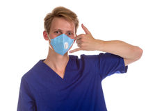 Portrait of a charming medical doctor gesturing call me with his Stock Photos