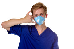 Portrait of a charming medical doctor gesturing call me with his Stock Images