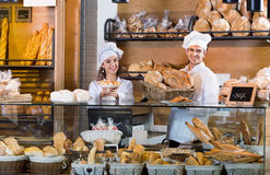 Portrait of charming positive smiling couple at bakery display Stock Image