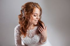 Portrait of a charming red-haired bride, Studio, close-up. Wedding hairstyle and makeup. Stock Image