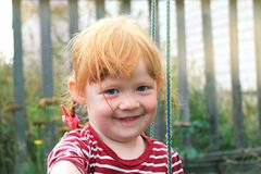 Portrait of the charming red-haired smiling girl Stock Photo