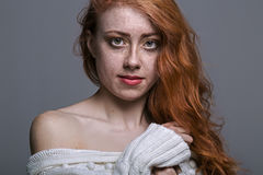 Portrait of a charming redheaded freckled woman Stock Photo