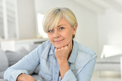 Portrait of charming senior lady relaxing in sofa Stock Image