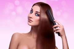 Portrait of charming sexy young adult woman with comb in studio Royalty Free Stock Images
