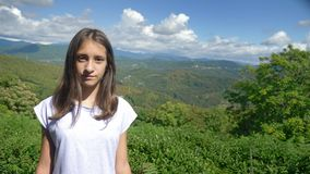 Portrait. charming teen girl on a background of magnificent mountain landscape and blue sky stock video footage